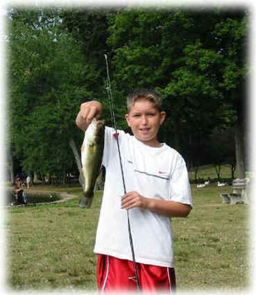 Photo of boy with largemouth bass